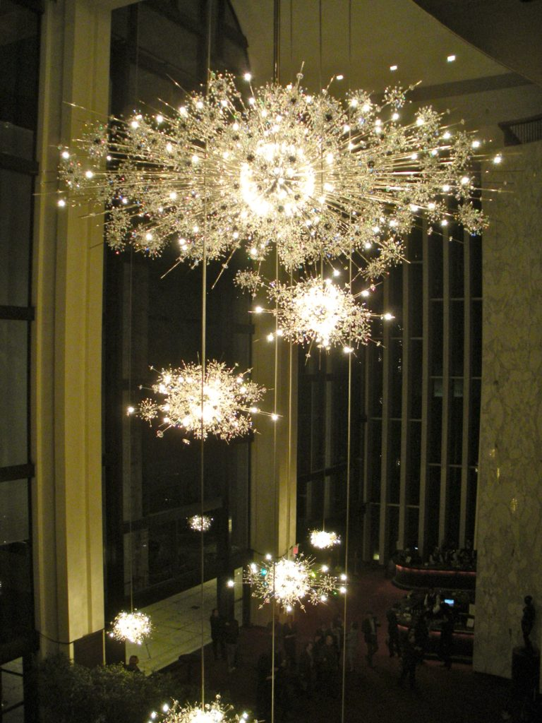 The iconic starburst chandeliers at The Metropolitan Opera House