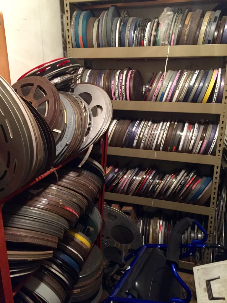 A collection of film canisters that are in the process of being digitized